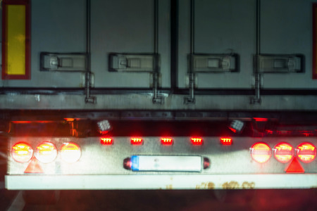 Photo for Red taillights on a truck. Truck view from behind with desired blur. - Royalty Free Image