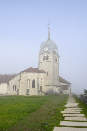Abbey church in Jura, France in the fog Abbaye lake and its abbey church, also known as Grandvaux lake, or Lake great river in Jura, France