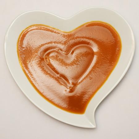 Heart shaped plate and pumpkin soup, healthy food