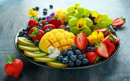 Photo for Colorful Mixed Fruit platter with Mango, Strawberry, Blueberry, Kiwi and Green Grape. Healthy food - Royalty Free Image