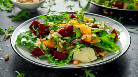Photo for Fresh Beet, Orange salad with wild rocket, cheese and Pine nuts. healthy summer food - Royalty Free Image