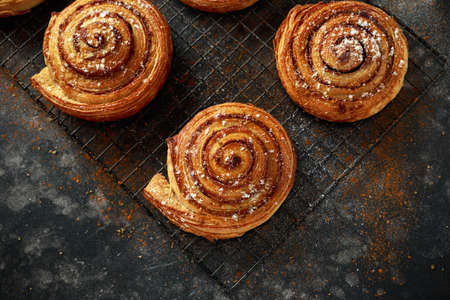 Photo for Freshly baked cinnamon swirls with icing sugar - Royalty Free Image