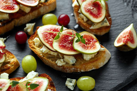 Photo for This Fig and Gorgonzola tartines, toast, bruschetta. drizzled with honey. - Royalty Free Image