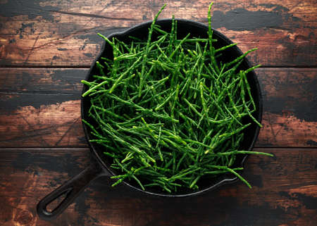 Photo for Fresh green samphire in cast iron skillet - Royalty Free Image