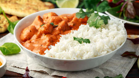 Photo for Chicken tikka masala curry with rice and naan bread - Royalty Free Image