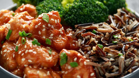 Photo for Teriyaki chicken, steamed broccoli and wild rice served in bowl - Royalty Free Image