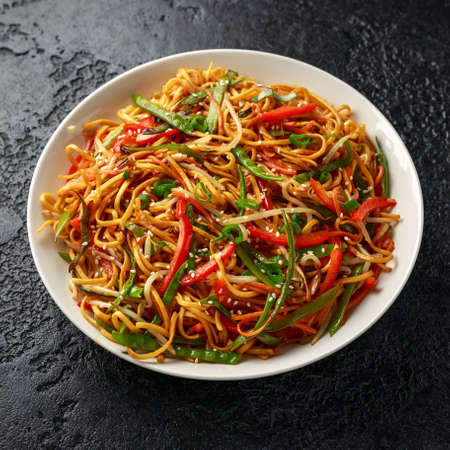 Photo for Chow mein noodle dish with vegetables. red pepper, carrot, mangetout and bean sprouts. - Royalty Free Image