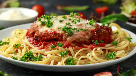 Photo for Chicken Parmesan with Cheese and Marinara Sauce served over spaghetti, pasta - Royalty Free Image
