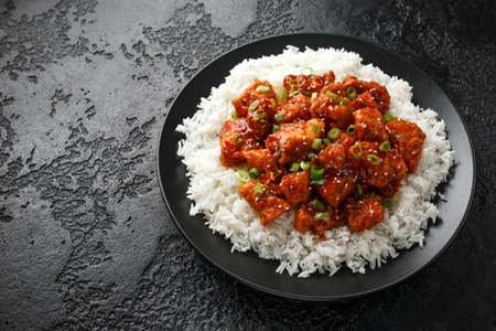 Photo for Tsos chicken with rice, green onion and broccoli - Royalty Free Image