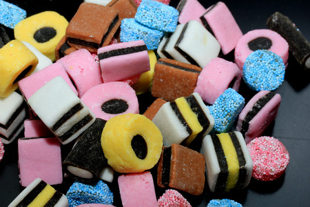Photo pour Stacked liquorice all sorts in different shapes, colors and sizes - image libre de droit