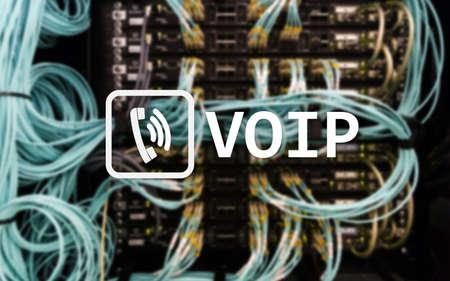Photo pour VOIP, Voice over Internet Protocol, technology that allows for speech communication via the Internet. Server room background. - image libre de droit