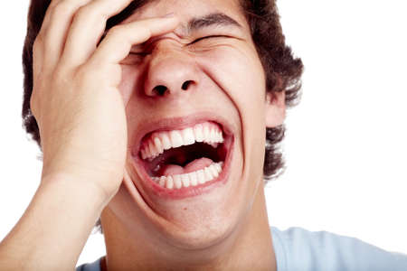 Foto de Laughing out loud young man face closeup - laughter concept - Imagen libre de derechos