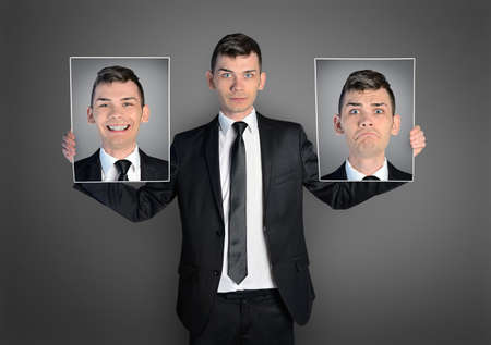 Photo for Business man with different faces - Royalty Free Image