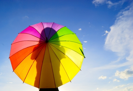 Photo for Shadow multicolor umbrella woman - Royalty Free Image