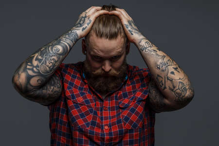 Photo pour Picture of brutal tattooed male with beard - image libre de droit