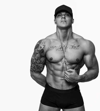 Photo for Muscular men with tattos isolated on white - Royalty Free Image