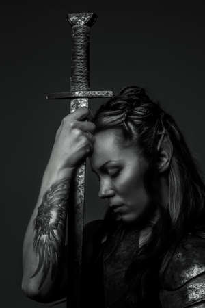 Photo for Elf woman with sword. Black and white photo - Royalty Free Image