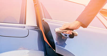 Photo for Close up image of a man opens car's door. - Royalty Free Image