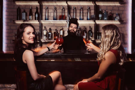 Photo for Cheerful female friends resting in the nightclub - Royalty Free Image