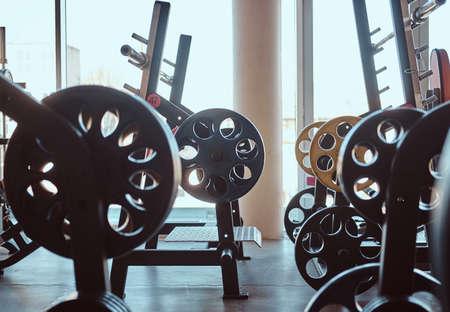 Foto de Photo of empty sunny gym full of different sport equipment. - Imagen libre de derechos