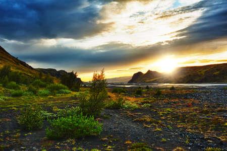 Midnight setting sun lits beautifully volcanic rocks and rivers at Thorsmork, Iceland