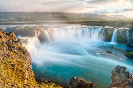 Photo for Godafoss is a very beautiful Icelandic waterfall. It is located on the North of the island not far from the lake Myvatn and the Ring Road. This photo is taken after the midnight sunset with a long exposure - Royalty Free Image