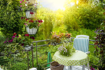 Foto de Summer Terrace or Balcony with small Table, Chair and Flowers - Imagen libre de derechos
