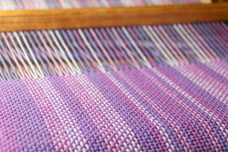 Photo for detail of fabric in comb loom with ultraviolet and lilac colors - Royalty Free Image