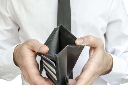 Man in white shirt and black tie holding an empty wallet