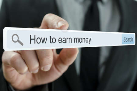 Foto de How to earn money written in search bar on virtual screen  - Imagen libre de derechos