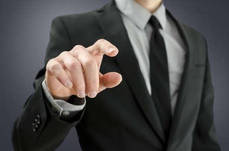 Foto de Closeup of businessman touching empty virtual screen. - Imagen libre de derechos