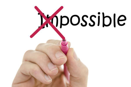 Foto de Crossing off the first two letters of word impossible. - Imagen libre de derechos