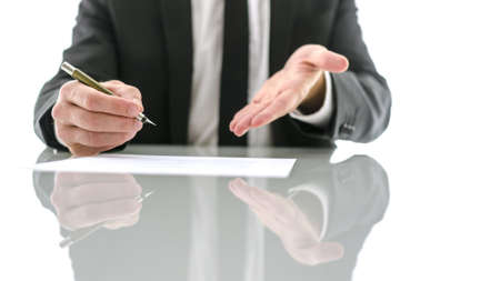 Photo for Front view of businessman kindly inviting you to sign a contract. - Royalty Free Image