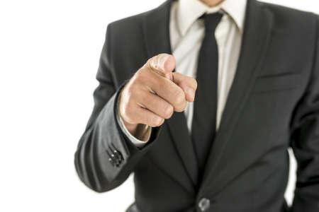 Foto de Closeup of businessman pointing finger at you. Isolated over white background. - Imagen libre de derechos