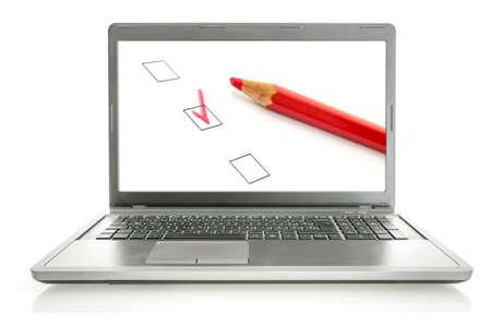 Photo pour Laptop with red pencil and check boxes on screen. Online survey concept. - image libre de droit