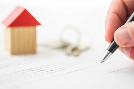 Photo for Closeup of signing contract of house sale. - Royalty Free Image