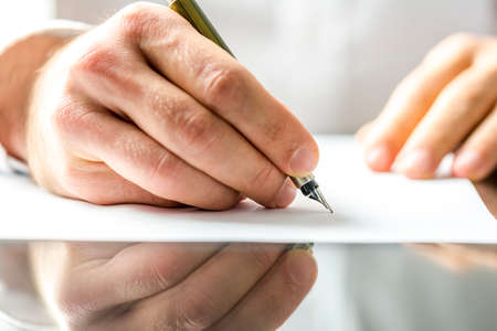 Photo for Man writing on a blank paper with ink pen. - Royalty Free Image
