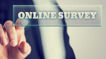 Foto de Male hand activating an Online survey button on virtual screen. - Imagen libre de derechos