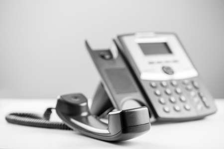 Photo pour Greyscale image of a telephone receiver off the hook to either effectively block the line or waiting for a person to arrive to take the call. - image libre de droit