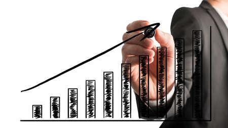Foto de Businessman drawing an ascending bar graph with a black marker pen on a virtual interface over a white background during a presentation or planning meeting. - Imagen libre de derechos