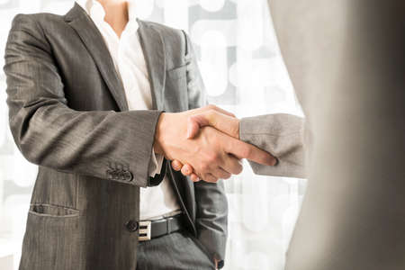 Photo pour Closeup of male and female business or political partners shaking hands in agreement. - image libre de droit