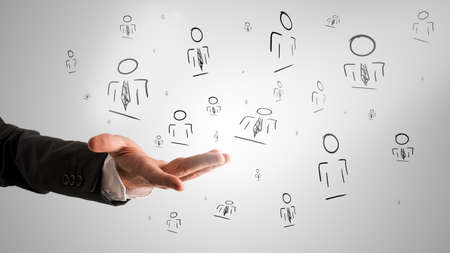 Foto de Customer managed relationship concept with a male hand presenting random people icons. - Imagen libre de derechos