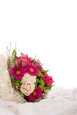 Photo for Colorful wedding bouquet of flowers on white dress material with copyspace. - Royalty Free Image