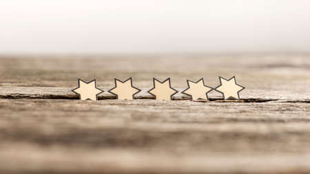 Photo pour Five stars in a row on a rustic wooden boards. Conceptual of excellent opinion. - image libre de droit