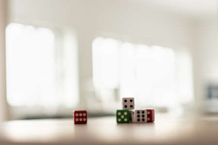 Photo pour Gaming dice stacked on desk in a bright office. - image libre de droit