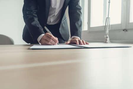 Photo pour Retro image of a lawyer signing legal document or testament with fountain pen. - image libre de droit