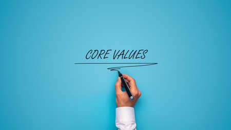Photo for Male hand writing Core values sign over blue background with black marker. - Royalty Free Image