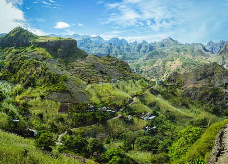 Photo pour Cape Verde. Gorgeous panoramic view of famous fertile Paul Valley. Agriculture terraces of sugarcane in vertical valley sides, people dwellings, rugged peaks and motion clouds on horizon - image libre de droit