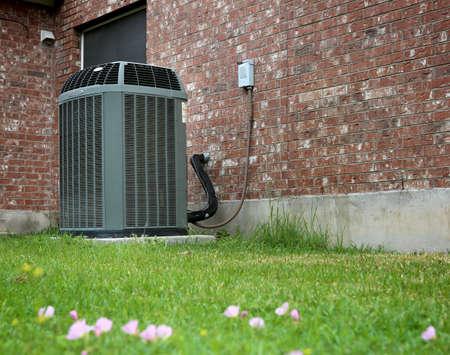 Photo pour High efficiency modern AC-heater unit on brick wall background - image libre de droit
