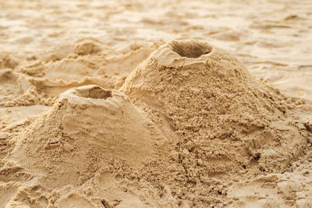 Photo for A volcano made of sand on the beach - Royalty Free Image
